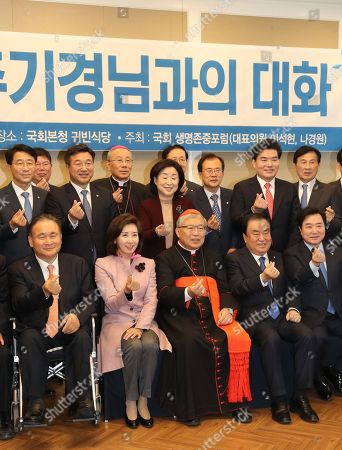 Cardinal Andrew Yeom Soo-jung (C, front) joins a group photo session with ruling and opposition lawmakers during a forum at the National Assembly in Seoul, South Korea, 01 November 2018.