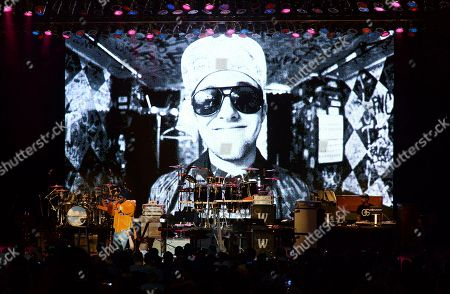Juicy J performs during the tribute event Mac Miller: A Celebration of Life, at the Greek Theatre in Los Angeles. Pictured on screen is the late rapper Mac Miller