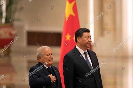 Salvador Sanchez Ceren, Xi Jinping. Salvadoran President Salvador Sanchez Ceren, left, standing next to Chinese President Xi Jinping, places his hand on his chest as the national anthem of El Salvador is played during a welcome ceremony held at the Great Hall of the People in Beijing, . The El Salvador President arrived in the Chinese capital just months after the small Central American nation broke its diplomatic ties with Taiwan