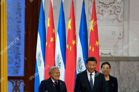 Salvadoran President Salvador Sanchez Ceren, left, walks with Chinese President Xi Jinping during a welcome ceremony held at the Great Hall of the People in Beijing, . The El Salvador President arrived in the Chinese capital just months after the small Central American nation broke its diplomatic ties with Taiwan