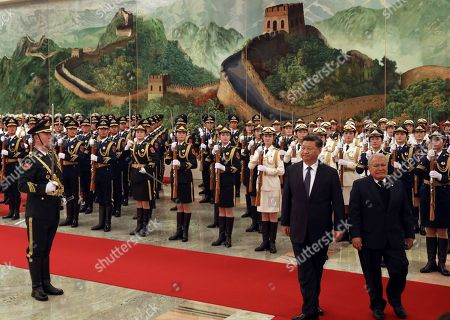 Salvador Sanchez Ceren, Xi Jinping. Salvadoran President Salvador Sanchez Ceren, right, walks with Chinese President Xi Jinping during a welcome ceremony held at the Great Hall of the People in Beijing, . The El Salvador President arrived in the Chinese capital just months after the small Central American nation broke its diplomatic ties with Taiwan