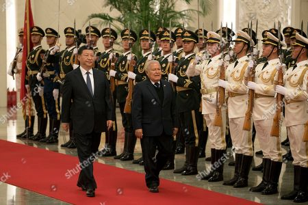 Salvador Sanchez Ceren, Xi Jinping. Salvadoran President Salvador Sanchez Ceren, center right, walks with Chinese President Xi Jinping during a welcome ceremony held at the Great Hall of the People in Beijing, . The El Salvador President arrived in the Chinese capital just months after the small Central American nation broke its diplomatic ties with Taiwan