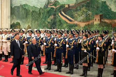 Salvador Sanchez Ceren, Xi Jinping. Salvadoran President Salvador Sanchez Ceren walks with Chinese President Xi Jinping during a welcome ceremony held at the Great Hall of the People in Beijing, . Ceren arrived in the Chinese capital just months after the small Central American nation broke its diplomatic ties with Taiwan