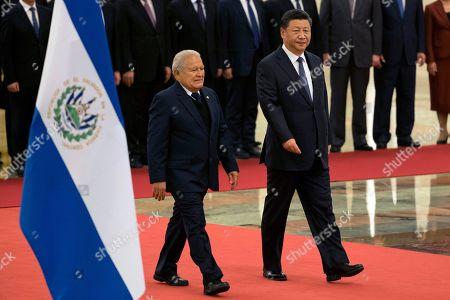 Salvador Sanchez Ceren, Xi Jinping. Salvadoran President Salvador Sanchez Ceren, left, walks with Chinese President Xi Jinping past an El Salvador state flag during a welcome ceremony held at the Great Hall of the People in Beijing, . The El Salvador President arrived in the Chinese capital just months after the small Central American nation broke its diplomatic ties with Taiwan