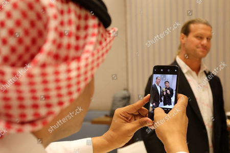 A Saudi man takes a picture with wrestler Dolph Ziggler, during the press conference in Riyadh, Saudi Arabia, 01 November 2018. Saudi Arabia is hosting the Crown Jewel World Wrestling Entertainment (WWE) event. This is the second event to be hosted in Saudi Arabia on the same year after the Royal Grand Rumble in April 2018 at the King Abdullah Bin Abdulaziz Sports City in Jeddah.