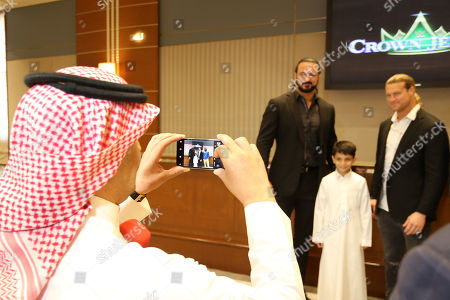 Wrestlers Drew McIntyre (C), Dolph Ziggler (right) pose with Saudi audience, during the press conference in Riyadh, Saudi Arabia, 01 November 2018. Saudi Arabia is hosting the Crown Jewel World Wrestling Entertainment (WWE) event. This is the second event to be hosted in Saudi Arabia on the same year after the Royal Grand Rumble in April 2018 at the King Abdullah Bin Abdulaziz Sports City in Jeddah.