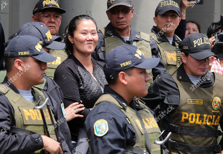 Keiko Fujimori (C), the main leader of the opposition in Peru, reacts as she is transferred to a prison to serve preventive detention, from the Palace of Justice, in Lima, Peru, 01 November 2018. A Peruvian judge ordered opposition leader Keiko Fujimori for up to 36 months in prison pending trial in a case involving allegations that she accepted illegal campaign contributions in her 2011 presidential run.