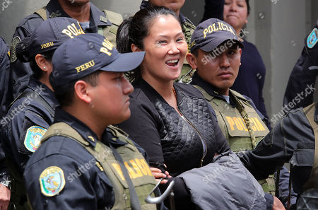 Stock Picture of Keiko Fujimori (C), the main leader of the opposition in Peru, reacts as she is transferred to a prison to serve preventive detention, from the Palace of Justice, in Lima, Peru, 01 November 2018. A Peruvian judge ordered opposition leader Keiko Fujimori for up to 36 months in prison pending trial in a case involving allegations that she accepted illegal campaign contributions in her 2011 presidential run.