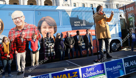 Amy Klobuchar, Tim Walz, Peggy Flanagan, Tina Smith. U.S. Sen. Amy Klobuchar, D-Minn., right, addressed those gathered for, at the State Capitol in St. Paul, Minn. for the kick-off of a bus tour around the state for Democratic candidates including, Democratic gubernatorial candidate Tim Walz second, from left, and running mate State Rep. Peggy Flanagan, left. U.S. Sen. Tina Smith, third from left, is in a special election race to fill the vacant seat of former Sen. Al Franken