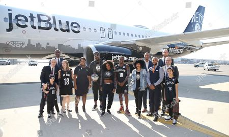 Stock Photo of IMAGE DISTRIBUTED FOR JETBLUE - JetBlue, Brooklyn Nets and BSE Global staff and models from left BSE Global CEO Brett Yormark, Nets Kid Dancer Sophia, Nets Legend Albert King, JetBlue VP, Marketing Elizabeth Windram, JetBlue Inflight crewmember Magda Odige, Lance Fresh of Bleacher Report, Brooklynette Ashley, Jesse Jones a.k.a. Filayyyy, social influencer Kia Marie, Nets Legend Kerry Kittles, JetBlue Inflight crewmember Peter Gonzalez, Nets General Manager Sean Marks, JetBlue EVP Commercial and Planning, Marty St. George, Nets Kid Dancer Kai celebrate as JetBlue reveals its newest aircraft - BK Blue - dedicated to the Brooklyn Nets on in New York