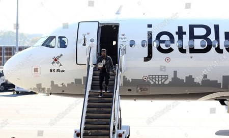 Stock Picture of IMAGE DISTRIBUTED FOR JETBLUE - Lance Fresh of Bleacher Report models the Brooklyn Nets Nike NBA City Edition merchandise line as JetBlue revealed its newest aircraft - BK Blue - dedicated to the Brooklyn Nets on in New York