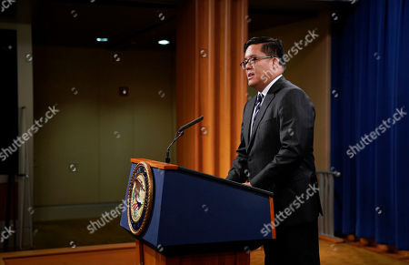 U.S. Attorney Alex G. Tse for the Northern District of California speaks during a news conference to announce a criminal law enforcement action involving China, at the Department of Justice in Washington, . Justice Department and FBI leaders announced criminal charges and an operation to thwart Chinese economic espionage