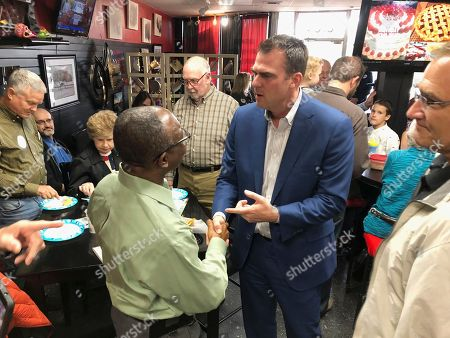 Kevin Stitt, the Republican nominee for Oklahoma governor, greets guests at Java 39 coffeehouse in Bethany, Okla. Stitt is locked in a tight race with Democrat Drew Edmondson to replace term-limited GOP Gov. Mary Fallin