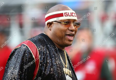 Rapper E-40 before an NFL football game between the San Francisco 49ers and the Oakland Raiders in Santa Clara, Calif