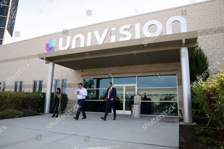 Fresno County Assistant District Attorney Andrew Janz, right, accompanied by campaign volunteer Matt Rogers, center, and campaign staffer Mari Harren, leaves the Univision station after participating in a television interview on November 1, 2018 in Fresno, California. Janz is running to unseat Rep Devin Nunes Republican of California.
