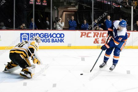 Josh Bailey, Matt Murray. New York Islanders right wing Josh Bailey (12) shoots the puck to score a goal against Pittsburgh Penguins goaltender Matt Murray (30) during the second period of an NHL hockey game, in New York