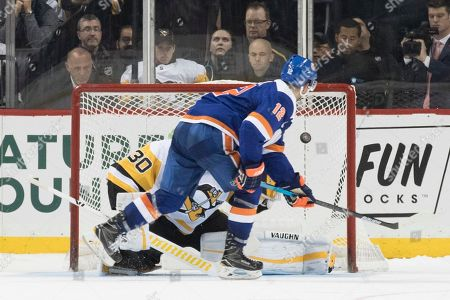 Josh Bailey, Matt Murray. New York Islanders right wing Josh Bailey (12) scores the winning goal past Pittsburgh Penguins goaltender Matt Murray (30) during the shoot out of an NHL hockey game, in New York. The Islanders won 3-2
