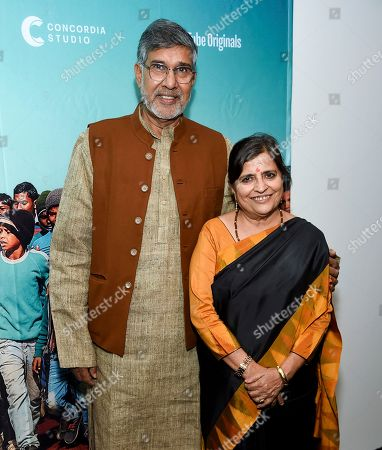 """Kailash Satyarthi, Sumedha Kailash. Indian children's rights activist and Nobel Peace Prize recipient Kailash Satyarthi, left, and wife Sumedha Kailash attend a special screening of """"The Price of Free"""" at the Museum of Modern Art, in New York"""