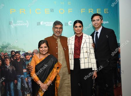"""Kailash Satyarthi, Sumedha Kailash, Rachel Roy, Rajendra Roy. Indian children's rights activist and Nobel Peace Prize recipient Kailash Satyarthi, left, and wife Sumedha Kailash, designer and UN Women Ambassador for Innovation Rachel Roy and The Celeste Bartos Chief Curator of Film at MoMA Rajendra Roy attend a special screening of """"The Price of Free"""" at the Museum of Modern Art, in New York"""