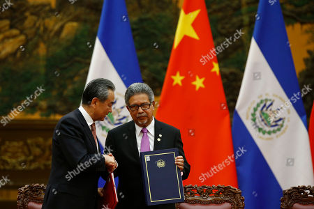 Chinese Foreign Minister Wang Yi (L) and El Salvador's Foreign Minister Carlos Castaneda (R) exchange documents at the Great Hall of the People in Beijing, China, 01 November 2018 (issued 02 November 2018).