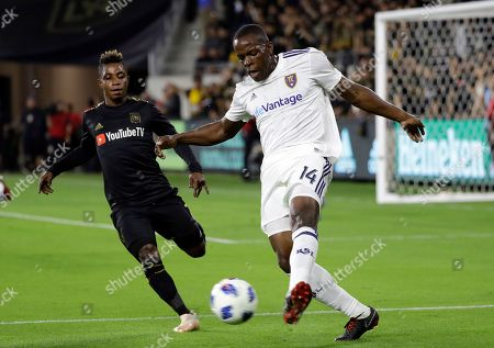 Nedum Onuoha, Latif Blessing. Real Salt Lake's Nedum Onuoha, right, clears the ball as Los Angeles FC's Latif Blessing closes in during the first half of an MLS soccer playoff match, in Los Angeles