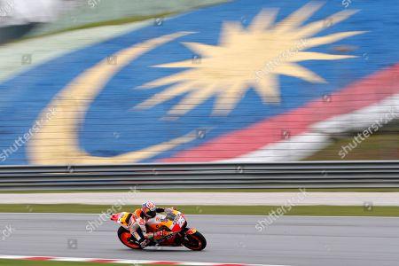 Dani Pedrosa of Spain steers his Honda during the free practice ahead of Malaysia MotoGP at Sepang International circuit in Sepang, Malaysia