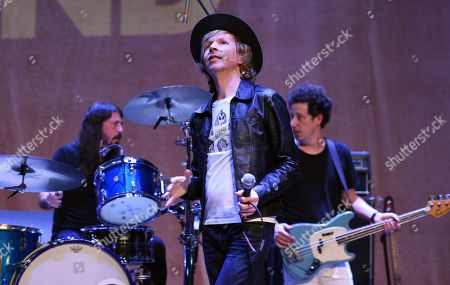 Beck, Dave Grohl, Justin Meldal-Johnsen. Beck, center, is joined by drummer Dave Grohl, left, and bassist Justin Meldal-Johnsen during his performance