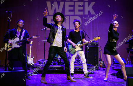 Beck, second from left, performs with band members