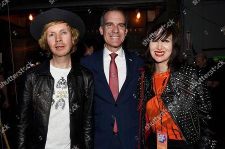 Beck, Eric Garcetti, Karen O. Los Angeles Mayor Eric Garcetti, center, poses with musical artists Beck, left, and Karen O backstage