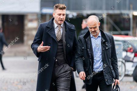 Danish soccer player Nicklas Bendtner (L) and his lawyer Anders Nemeth arrive at the Copenhagen City Council, in Copenhagen, Denmark, 02 November 2018. Nicklas Bendtner has been charged with violence against a taxi driver in Copenhagen while the driver has been charged with attempted violence.