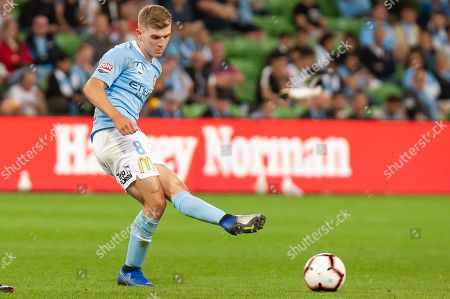 Melbourne City midfielder Riley McGree (8) passes the ball across at the Hyundai A-League Round 3 soccer match between Melbourne City FC and Sydney FC at AAMI Park in Melbourne.