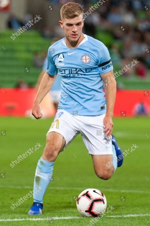 Melbourne City midfielder Riley McGree (8) runs the ball passed Sydney defence at the Hyundai A-League Round 3 soccer match between Melbourne City FC and Sydney FC at AAMI Park in Melbourne.