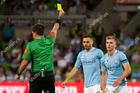 Melbourne City midfielder Riley McGree (8) is shown a yellow card at the Hyundai A-League Round 3 soccer match between Melbourne City FC and Sydney FC at AAMI Park in Melbourne.