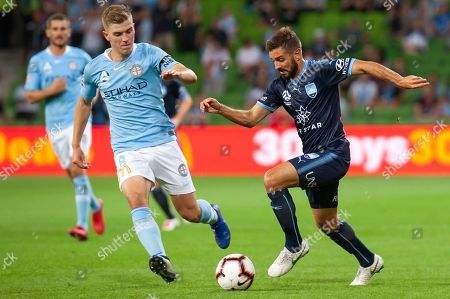Sydney FC defender Michael Zullo (7) fights for the ball against Melbourne City midfielder Riley McGree (8) at the Hyundai A-League Round 3 soccer match between Melbourne City FC and Sydney FC at AAMI Park in Melbourne.