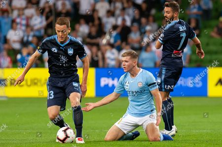 Melbourne City midfielder Riley McGree (8) is taken down at the Hyundai A-League Round 3 soccer match between Melbourne City FC and Sydney FC at AAMI Park in Melbourne.