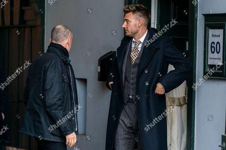 Danish soccer player Nicklas Bendtner (R) and  his lawyer Anders Nemeth leave Copenhagen City Court, in Copenhagen, Denmark, 02 November 2018. Bendtner was sentenced to 50 days in prison for violence against a taxi driver in Copenhagen.