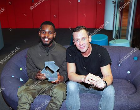 Dave accepting his Official Singles Chart Number 1 award for Funky Friday featuring Fredo from Scott Mills