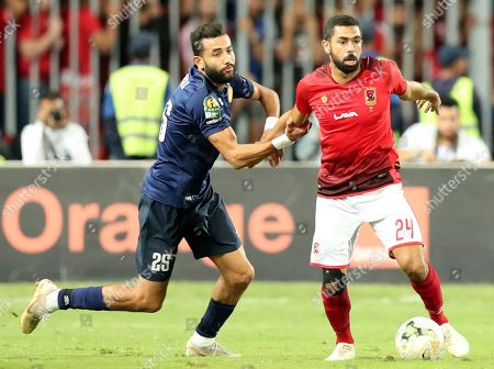 Stock Picture of Ahmed Fathy (R) of Al Ahly fights for the ball with Ghaylen Chaaleli  of ES Tunis during the CAF Champions League final 1st leg match between Al Ahly and ES Tunis at Borg Al Arab Stadium in Alexandria, Egypt, 02 November 2018.
