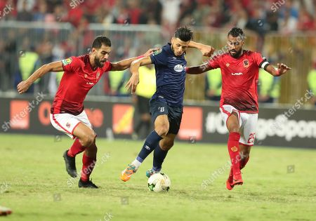 Amr Elsolia (L) Hossam Ashour (R) of Al Ahly fights for the ball with Anice Badri (C) of ES Tunis during the CAF Champions League final 1st leg match between Al Ahly and ES Tunis in Alexandria, Egypt, 02 November 2018.