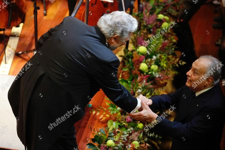 Stock Photo of Spanish tenor Placido Domingo (L) greets Indian conductor Zubin Mehta (R), during a concert offered by the orchestra of Reina Sofia Music academy on the occasion of the 80th anniversary of Queen Sofia in Madrid, Spain, 02 November 2018. Spain's Emeritus Queen Sofia turns 80 on 02 November 2018.