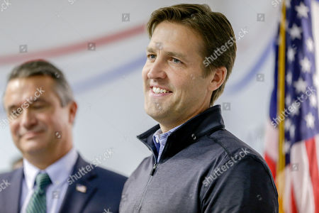 Sen. Ben Sasse, R-Neb., stands on stage with Rep. Don Bacon, R-Neb., left, during a Nebraska Republican Party Get Out The Vote rally tour stop in Omaha, Neb