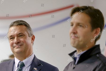 Rep. Don Bacon, R-Neb., left, stands on stage with Sen. Ben Sasse, R-Neb., during a Nebraska Republican Party Get Out The Vote rally tour stop in Omaha, Neb