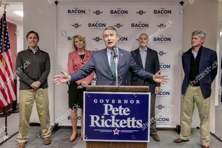 Rep. Don Bacon, R-Neb., is joined on stage with Sen. Ben Sasse, R-Neb., left, Omaha Mayor Jean Stothert, second left, Neb. Gov. Pete Ricketts, second right, and Rep. Jeff Fortenberry, R-Neb., right, during a Nebraska Republican Party Get Out The Vote rally tour stop in Omaha, Neb