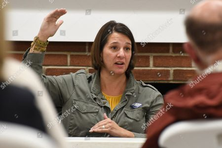 Jess King, a Democratic candidate for Congress in Pennsylvania's 11th District, responds to a question at a town hall meeting at a recreation center on in Red Lion, Pa. Voters in the heart of Pennsylvania's rolling dairy farms and Amish countryside have rarely seen a Democrat mount a competitive campaign for Congress. From all appearances, King is giving freshman Republican U.S. Rep. Lloyd Smucker a fight to the finish in Tuesday's election in this conservative district