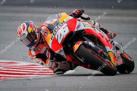 Honda rider Dani Pedrosa of Spain steers his bike during the third free practice ahead of Malaysia MotoGP at Sepang International Circuit in Sepang, Malaysia