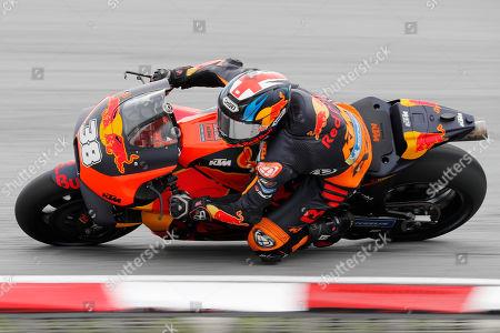 KTM rider Bradley Smith of England steers his bike during the third free practice ahead of Malaysia MotoGP at Sepang International circuit in Sepang, Malaysia