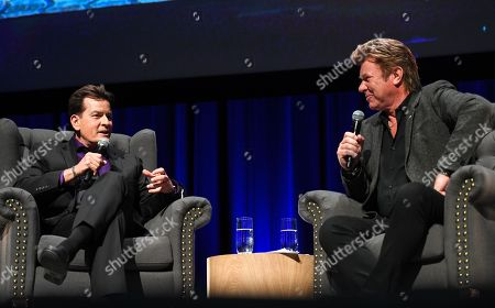 Charlie Sheen is seen on stage during his 'An Evening With Charlie Sheen' live show, hosted by Australian television presenter Richard Wilkins (R), at Melbourne Convention Centre, in Melbourne, Victoria, Australia, 03 November 2018. Charlie Sheen is in Australia for his first speaking tour.