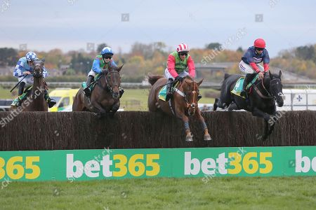 DEFINITLY RED (1) ridden by Danny Cook and trained by Brian Ellison jump the first fence before going on to  win The Class 1 bet365 Charlie Hall Steeple Chase over 3m (£100,000)  during the Bet365 Meeting at Wetherby Racecourse, Wetherby. Picture by Mick Atkins