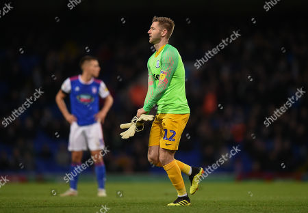 Paul Gallagher of Preston North End is forced to take over goalkeeping duties for Chris Maxwell goalkeeper of Preston North End after he was sent off
