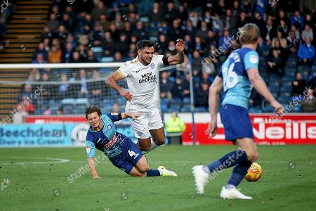 Peterborough United defender Ryan Tafazolli (5) is fouled by Wycombe Wanderers Dominic Gape(4) during the EFL Sky Bet League 1 match between Wycombe Wanderers and Peterborough United at Adams Park, High Wycombe
